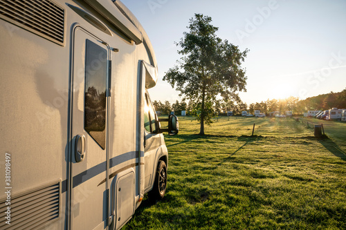 motorhome in detail before rising sun with morning dew against the light Fototapet