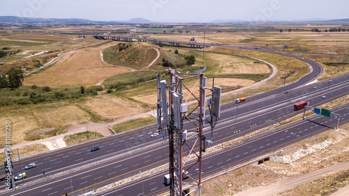 Fototapeta 5G cellular communication antenna near highway road.