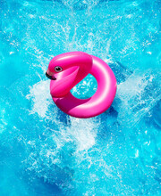Inflatable Flamingo Buoy Splash Into The Swimming Pool View From Above