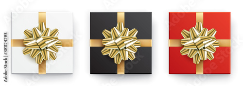 Valokuvatapetti Set of white, black and red vector gift boxes with golden ribbons, isolated on a white background