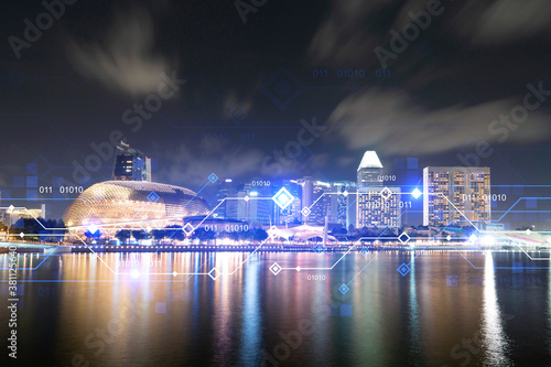 Obraz Information flow hologram, night panorama city view of Singapore. The largest technological center in Asia. The concept of programming science. Double exposure. - fototapety do salonu