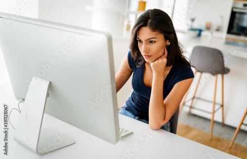 Fototapeta Beautiful young woman working on computer. Technology, people, work, study concept obraz