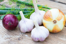 Onion And Garlic Closeup On Vintage Wooden Background, Harvesting. Healthy Food, Vitamins