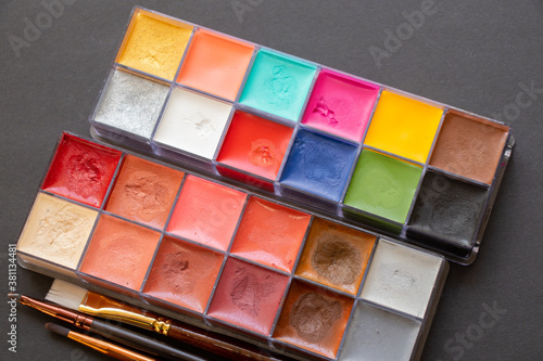 multi-colored eyeshadows for make-up and brushes on a dark background, beauty fa Tableau sur Toile