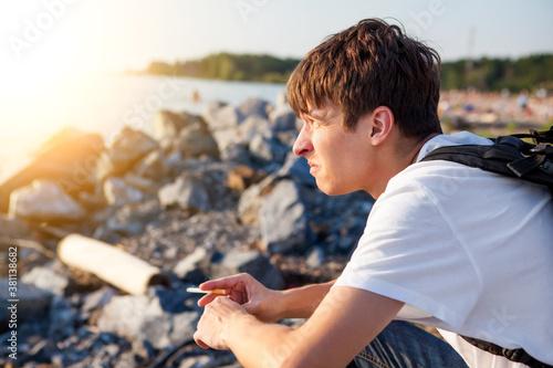 Photo Unhappy Young Man outdoor