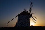 Old flour mill with a very colorful sunset background