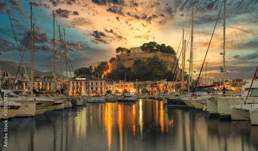 Fototapeta Views of Denia from the port on a September sunset