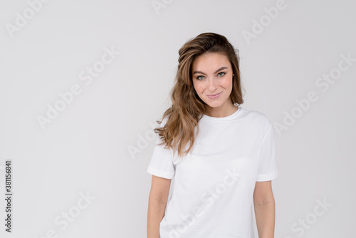 Fototapeta Portrait of young cheerful smiling woman, over white background obraz