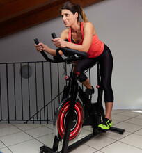 Woman Spinning At Home Exercising For Their Legs And Cardio Training