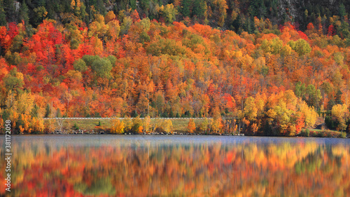 Scenic route Ducarme in northern Quebec along Saint Maurice river in autumn time Wallpaper Mural