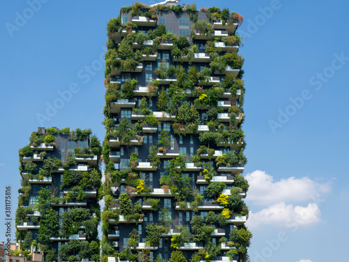 Milano, Italy. Bosco Verticale, view at the modern and ecological skyscraper with many trees on each balcony. Modern architecture, vertical gardens, terraces with plants