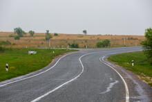 Asphalt Road Receding Into The...