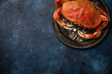 The Big King Crab On Round Bla...