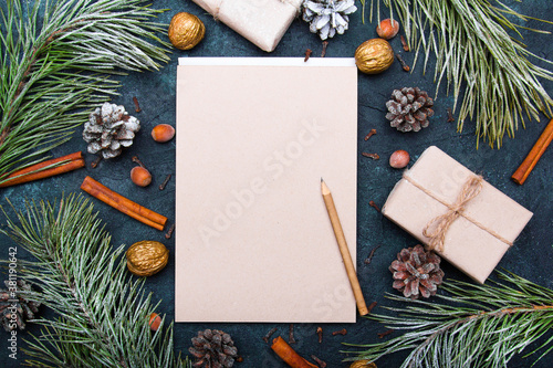 Fototapeta Christmas background with blank notebook surrounded by Christmas decorations. Letter to Santa or Christmas shopping list obraz