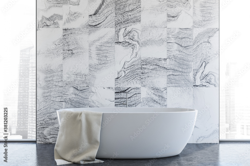 Tub in modern white marble bathroom