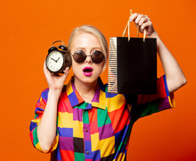 Style Blonde In 90s Shirt And Glasses With Shopping Bag