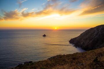 sunset in the sea of finisterre, orange yellow and blue sky