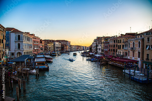 View of the Grand Canal in Venice with sun falling on horizon Fotobehang
