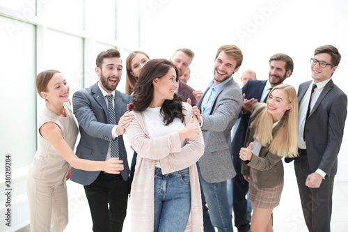 happy business team admiring their young leader Canvas Print