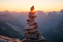 Stacked Rocks With Sunset Overlooking Mountains. Balanced Zen Rocks