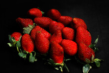 A Pile Of Strawberries With Lo...