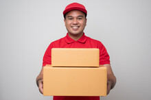 Young Smiling Asian Delivery M...