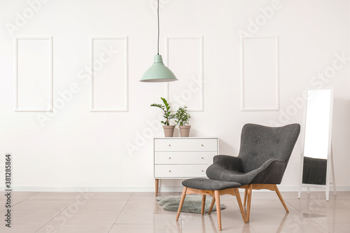 Fotomural Stylish armchair and ottoman with chest of drawers and mirror in room