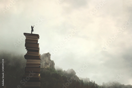 Photo surreal man with telescope looks at infinity from the top of a stack of books in
