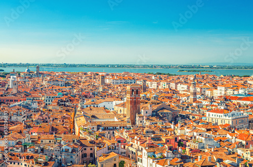Aerial panoramic view of Venice city old historical centre, buildings with red tiled roofs, San Giuliano Mestre and blue sky background, Veneto Region, Northern Italy. Amazing Venice cityscape..