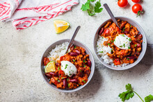 Chili Con Carne With Rice In Gray Bowl, Top View. Beef Stew With Beans In Tomato Sauce With Sour Cream And Rice. Traditional Mexican Food Concept.