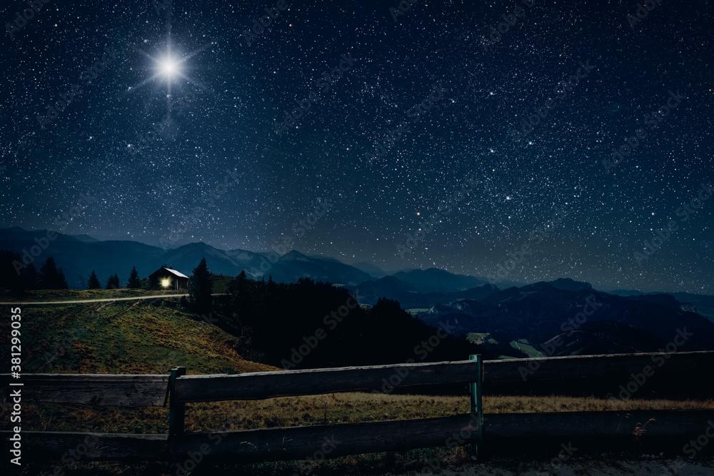 Fototapeta The star shines over the manger of christmas of Jesus Christ.