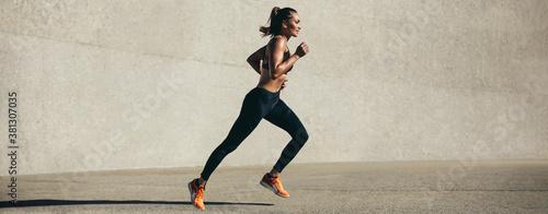 Fototapeta Healthy young woman on morning run obraz