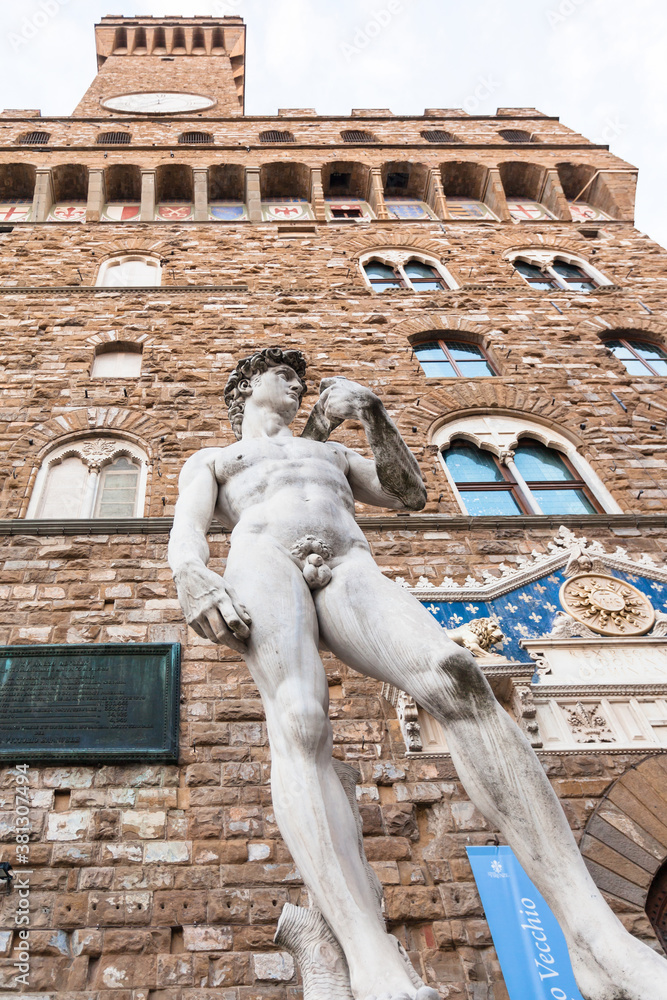 FLORENCE, ITALY - NOVEMBER 4, 2016: bottom view of Copy of statue David at the entrance of the Palazzo Vecchio in Florence city. David is Renaissance sculpture created in 1501 - 1504 by Michelangelo