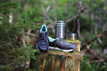 Hiking Boots With A Thermos On...