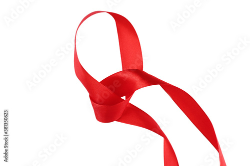 Vászonkép intertwined red ribbon separating white background