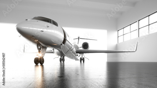Fotografiet A luxury white private business jet with black wings is parked in airy hangar awaiting first-class passengers for an international flight