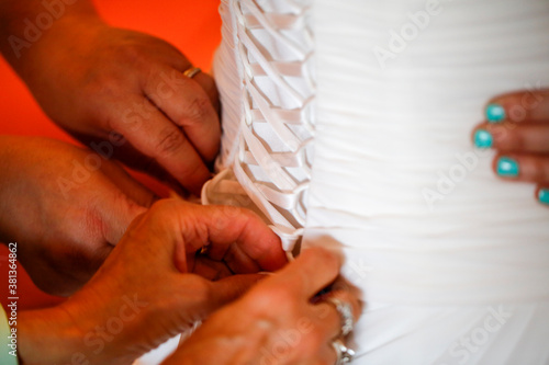 dressing the bride, lacing the bodice dress. High quality photo Canvas Print