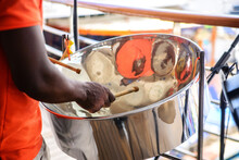 Man Is Playing On A Steel Drum...