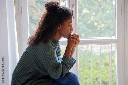 Fototapeta Black woman feeling depression symptoms alone at home obraz