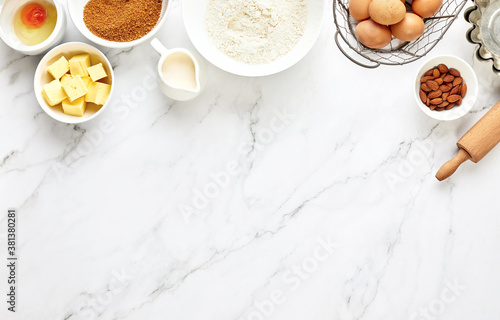 Tela Baking background with ingredients standing on a marble table surface