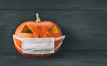 Halloween Pumpkin Wearing A Protective Medical Mask. New Normal Concept