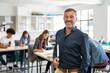 Leinwandbild Motiv Mature man professor standing in class
