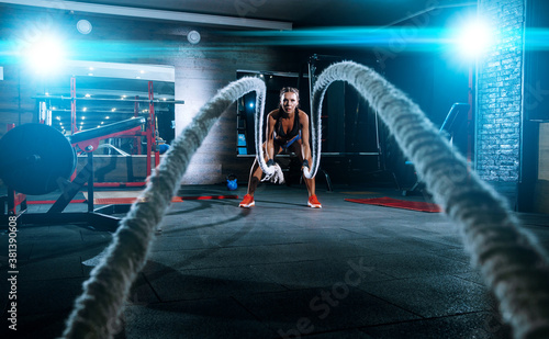 beautiful young black sportswoman in the gym. performs a workout. Canvas