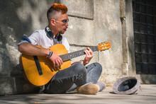 Portrait Of Street Musician Gu...