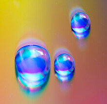 Water Drops On A Rainbow Background.