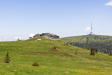 Petrovy Kameny Rock Formation. Venue For Witches' Covens In Past. TV Tower On Praded In Background. Summer Sunny Day In Jeseniky Mountains, Czech Republic.