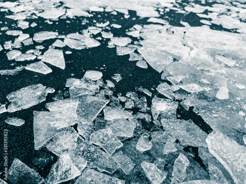 Fototapeta Broken ice on the ground as a background.