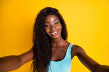 Photo Portrait Of Charming African American Woman Taking Making A Selfie Wearing Blue Singlet Isolated On Vivid Yellow Colored Background