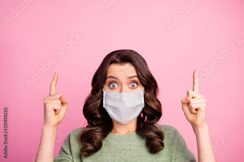 Obraz Portrait of astonished girl point index finger copyspace indicate covid infection quarantine news wear medical mask sweater pullover jumper isolated over pastel color background - fototapety do salonu