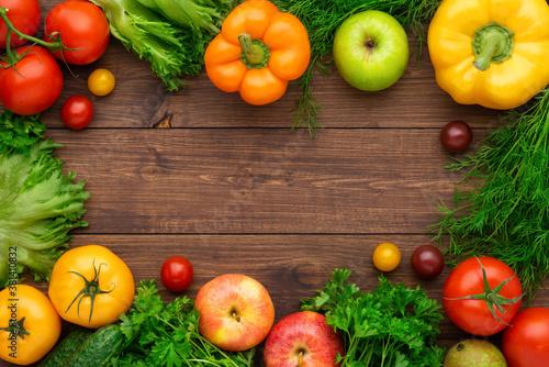 Fototapeta Healthy eating ingredients: fresh vegetables, fruits and superfood. Wooden background obraz